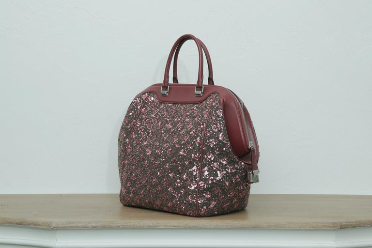 This is a Brand New authentic, Limited Edition LOUIS VUITTON Sequin Monogram Sunshine Express North South in Burgundy. This Louis Vuitton Speedy is entirely covered in sequins embellished with the Louis Vuitton monogram.  The bag features matching