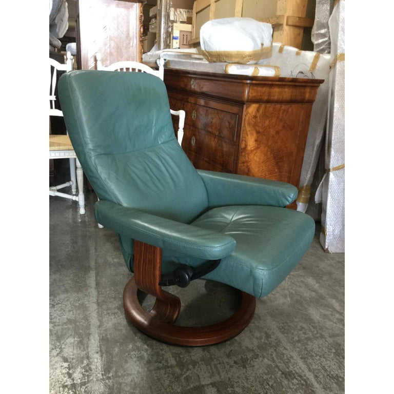 Beautiful pair of Scandinavian Eckhorns Stressless leather chairs with ottomans. Upholstered in soft greenish blue leather, these chairs are famous for providing the utmost comfort. The leather is super soft and is in mint condition.