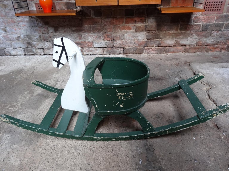 French vintage lovely 1920 antique painted rocking horse.  Measures: Height 51cm, depth 40cm, width 115cm.