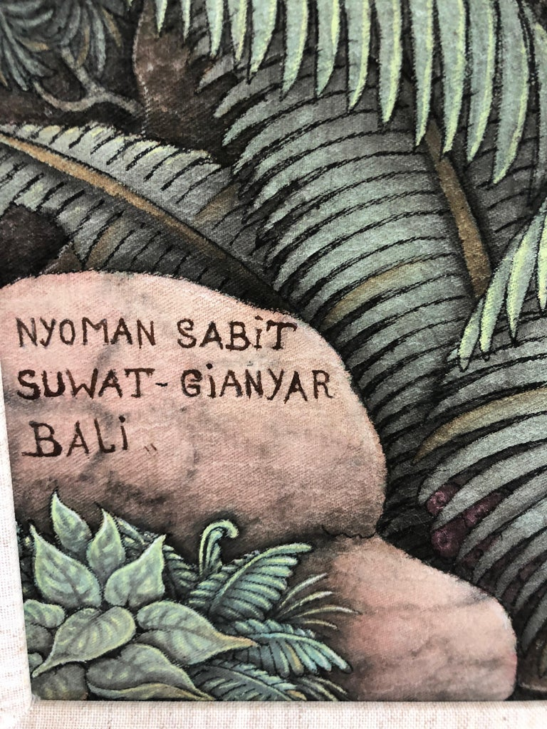 An eye poppingly large and meticulously detailed Balinese painting having a 1 inch linen mat liner and simple gold frame.