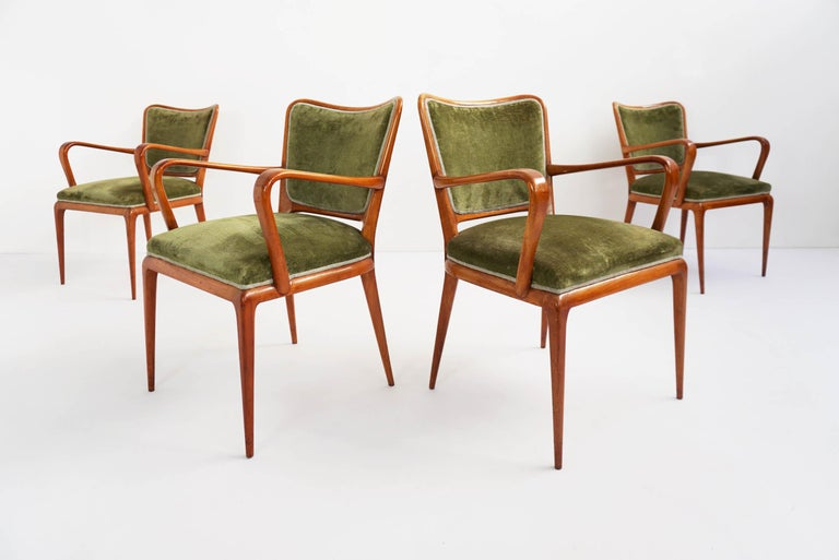 Rare set of four chairs with arms and tinny sexy legs. Made in cherrywood, green original fabric in perfect vintage condition.
