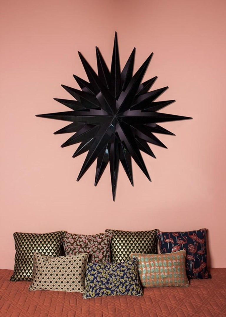 Super star black mirror Mirror 4mm faceted mirror on black painted mdf Measures: W 108 x H 116 x D 15 cm  The super star mirror will reflect the beauty of your space and convey a simple yet dramatic eclectic style to any room.  Reflections