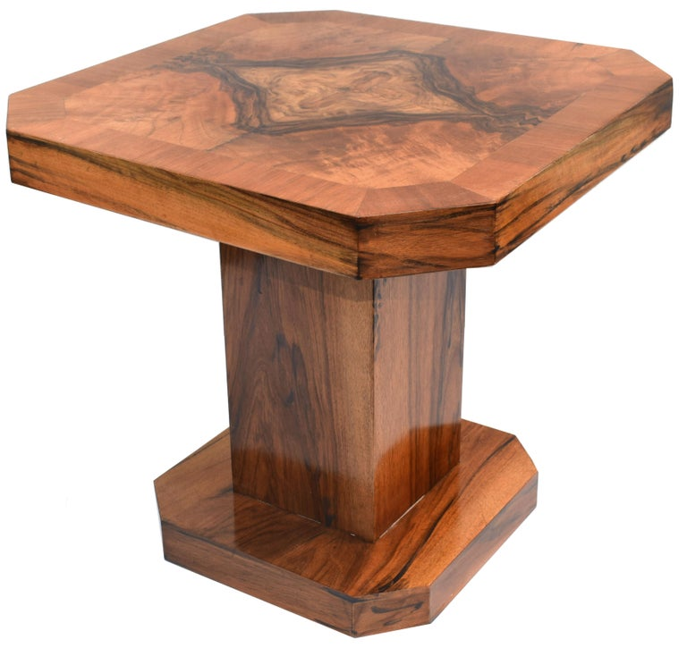 Fabulous and original 1930s Art Deco geometric occasional table. This table is ideal for modern day use either as a coffee table or center table. The veneers are an absolute delight with figuring on every angle, the top boasts highly figured and