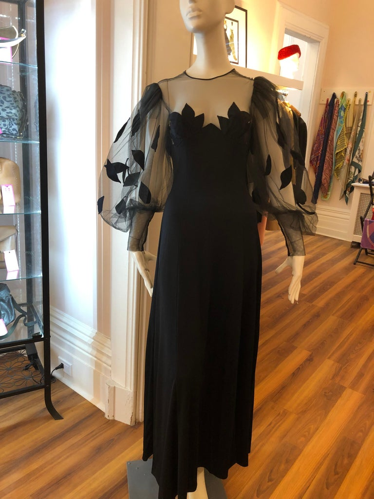 This black Loris Azzaro vintage gown has wonderful detail from the stretch jersey to the net with applique, and the balloon sleeves narrowing to the cuffs which are zippered.  The back is net sheer to under the bust line and has a discreet zipper