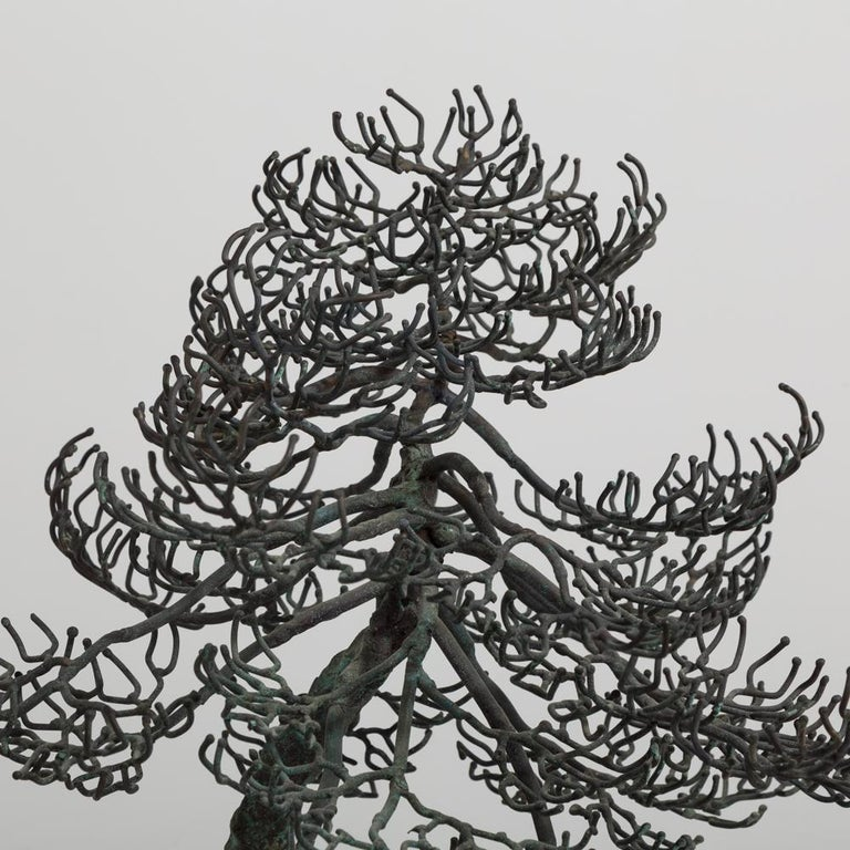 A superb bonsai tree table sculpture in bronze showing a gnarled twisted tree in winter mounted on a specimen rocky base mid-1960s.  Bonsai started in Japan in the 6th century. Bonsai or the art of Pen Jung translates to tray planting. Originally,