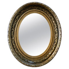 Superb Deep Oval Frame French Empire Gilt and Lacquer Wall Mirror