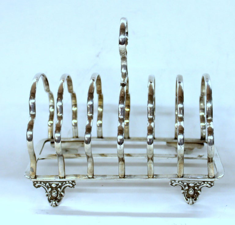Fine Quality seven-bar toast or letter rack on lovely cast feet Maker's marks for illustrious silversmiths, Harrison Bros. and Howson -Sheffield-.