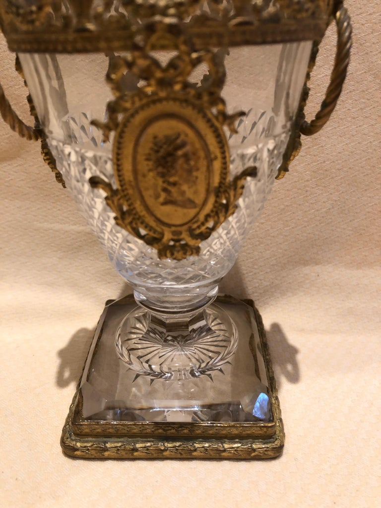 A magnificent small cut crystal vase having ornate ormolu mountings with swag and central cameo as well as side rings.