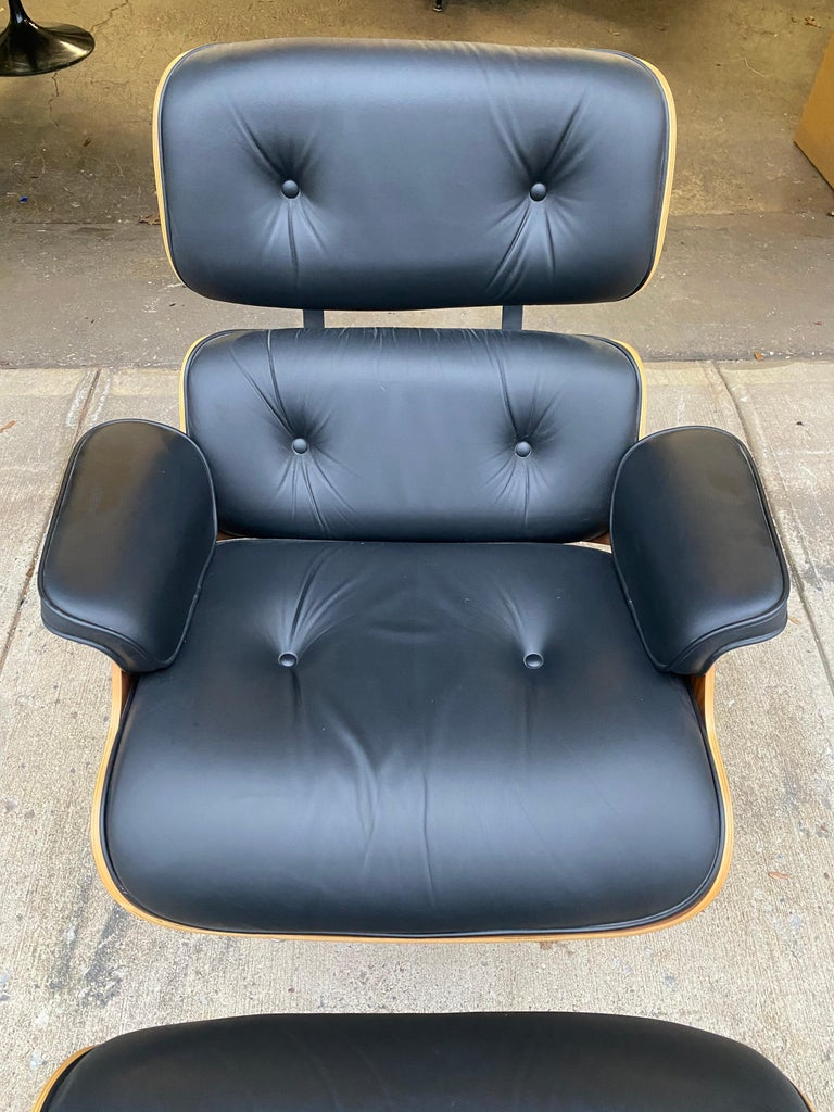 Gorgeous Classic Herman Miller Eames lounge chair and ottoman. Executed in original black leather and walnut shells. This chair was hardly used and the leather is like new. Signed and guaranteed authentic. Beautiful walnut tones and grain detail.