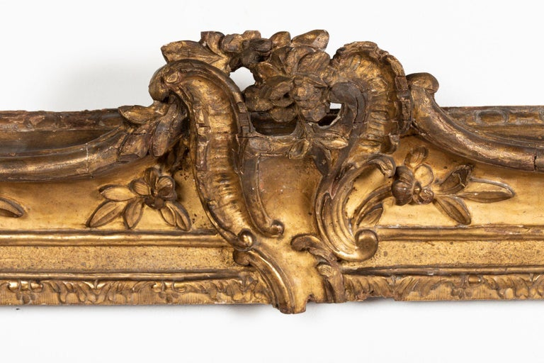 Superb Louis XV period, carved giltwood frame that can be turned into a mirror, France, mid-18th century Mirror plate is not included Horizontal, ornated with scrolls of flowers and leaves, stylized scallop shells in the corner, acanthus leave on