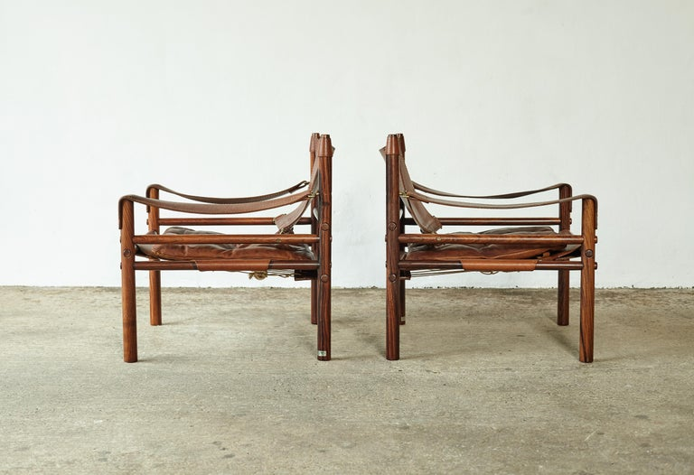 Wood Superb Pair of Arne Norell Rosewood Safari Chairs, Sweden, 1970s