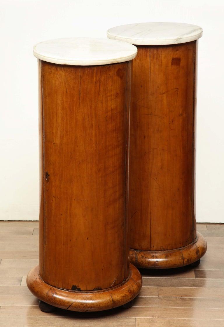 A superb pair of Austrian marble topped columns, circa 1830.
