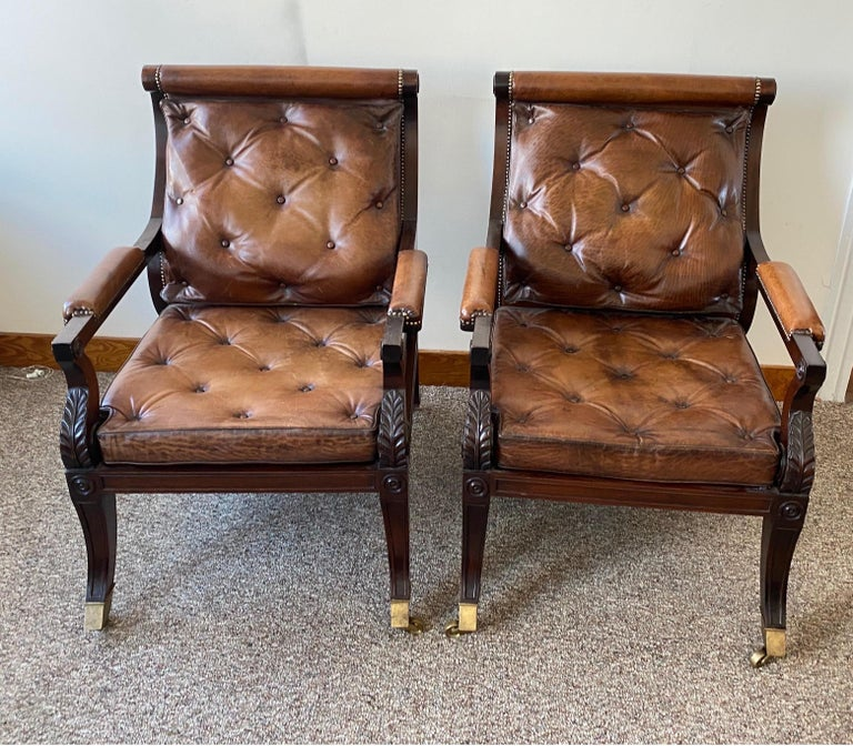Superb pair of Regency style mahogany and leather library chairs, after Gillows. English. Nice, deep comfortable seats. Great castors. Perfectly worn leather.