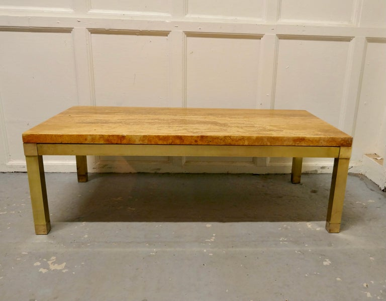"""Superb quality French Art Deco brass and marble coffee table.  This is a a very attractive piece the base and legs are in square brass and the heavy figured marble top is in amber tones known as """"Jasper Jaune""""  A good looking piece it is sound"""