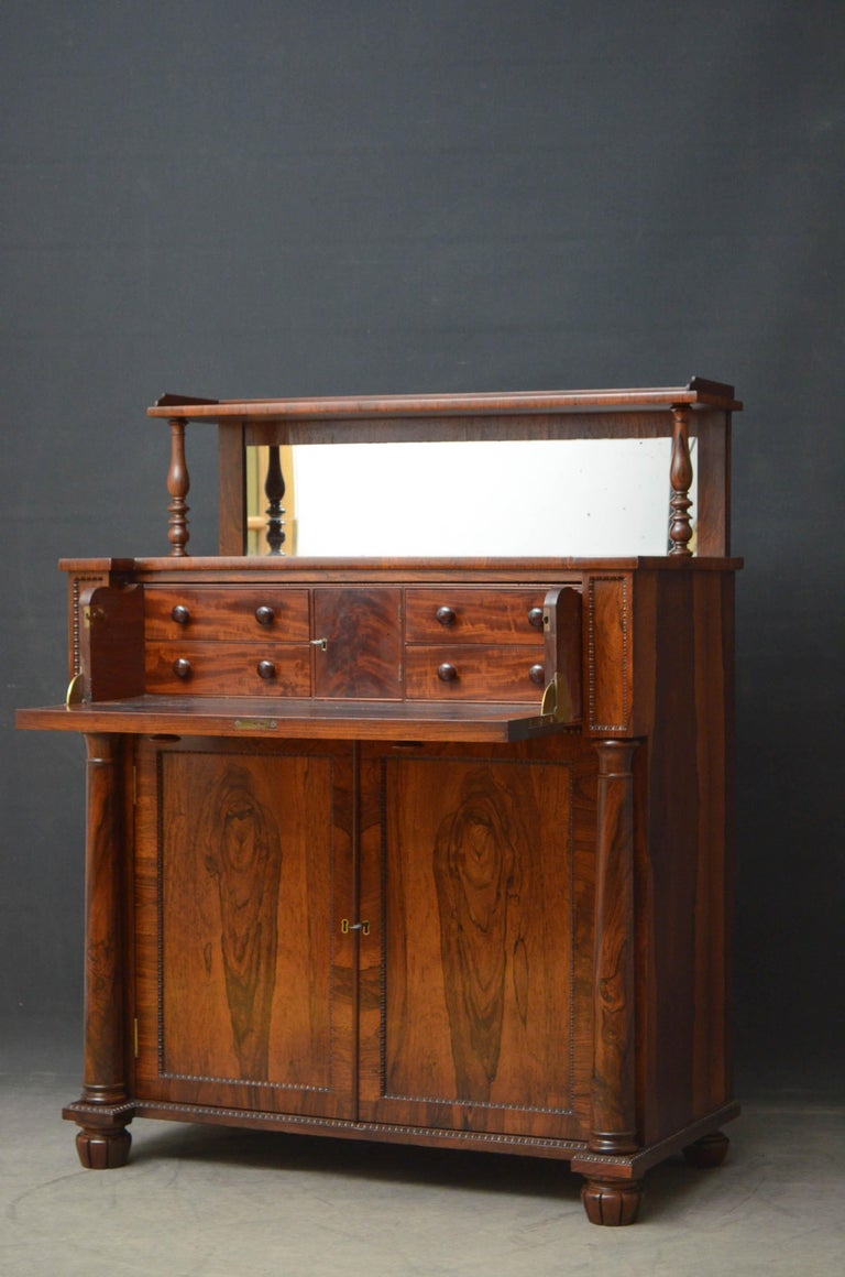 Sn4726 superb Regency chiffonier in rosewood in the manner of Gillows, having mirrored upstand to the back and fantastic top above a secretaire section which opens to reveal a cupboard, small drawers and leather writing surface, the base having a