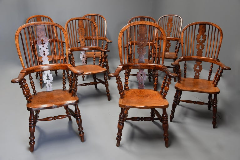 A superb rare set of eight 19th century burr yew broad arm high back Windsor armchairs of superb patina from the North of England, probably Yorkshire.