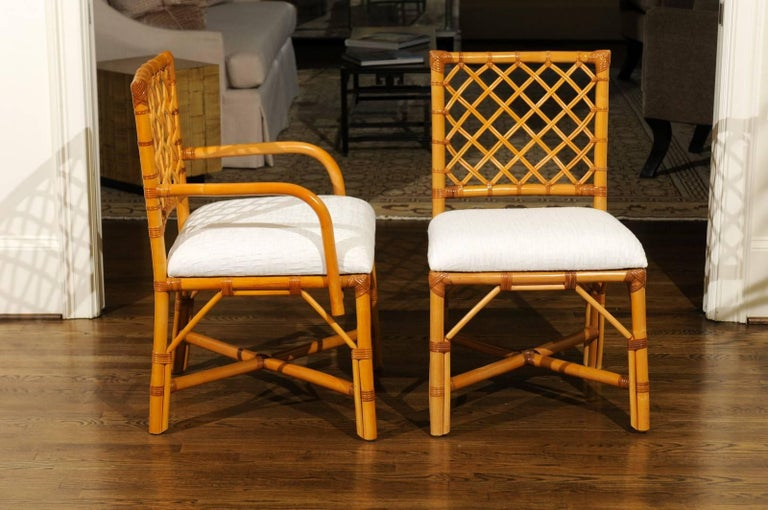 Superb Restored Set of Eight Vintage Rattan and Cane Lattice Back Dining Chairs In Excellent Condition For Sale In Atlanta, GA
