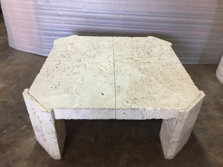 This vintage table made of natural coquina coral stone from the 1960s, was found in a Fisher Island estate. This coffee table is very uniquely designed; constituting of four geometric coquina coral stone corner bases/legs and a solid (2 inch thick)