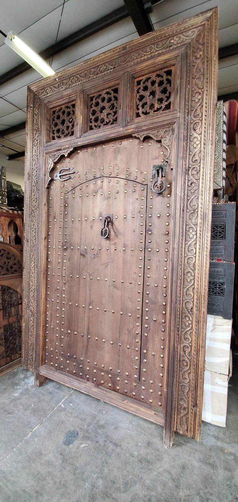 Superb Vintage Handmade Moorish Carved Door Within a Door In Excellent Condition For Sale In West Palm Beach, FL