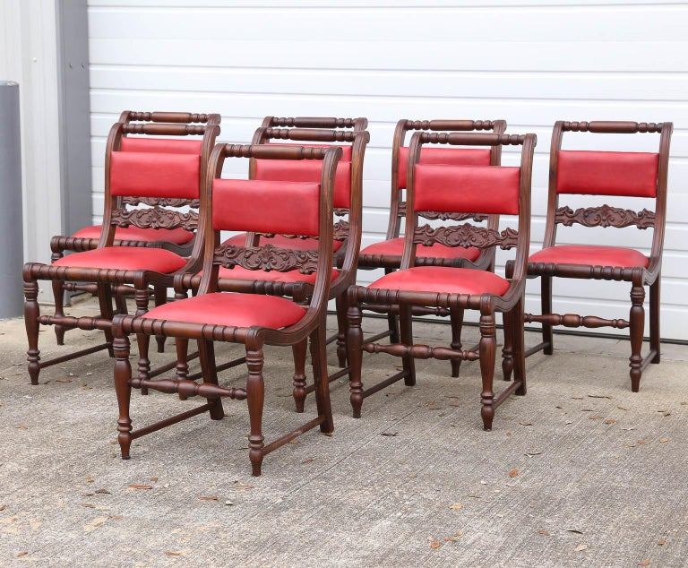 Set of modern ten teak wood and leather dining chairs. These are handcrafted in old world carpentry. Elegant and comfortable these ten chairs will light up any ceremonial dining halls. Offered by one of the largest dealer in colonial furniture.