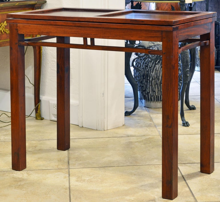 Fashioned in the classical Ming style with corner legs, small frieze and humpback stretchers these game table is a more modern elegant translation of the old Chinese tradition. Great craftsmanship in construction as well as in the four delicate