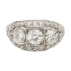 Superlative Art Deco 2.20 Carat Diamond Plus .70 Carat Platinum Three-Stone Ring