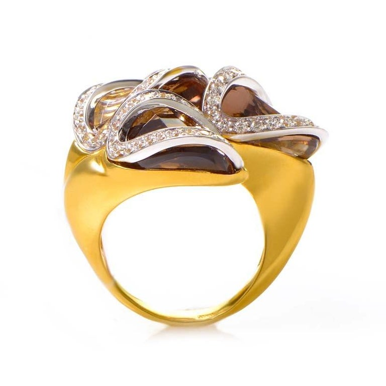 This ring from Superoro is sensual and sophisticated. It is made of 18K yellow gold and boasts ~10ct of smokey topaz accented with ~1.15ct of diamonds.