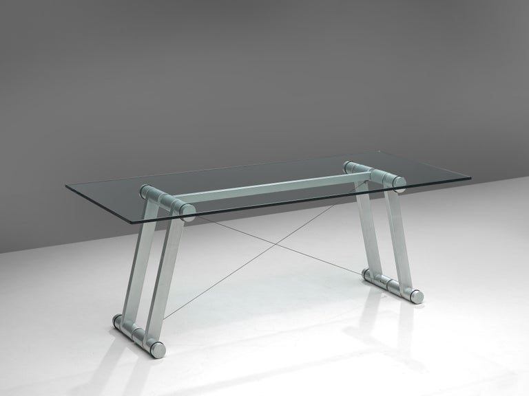 Superstudio, dining table 'Teso', metal, glass, Italy 1970s  Exceptional table by the Italian architecture and design group Superstudio (founded in 1966 by Adolfo Natalini and Cristiano Toraldo di Francia). The rectangular table has a clear glass