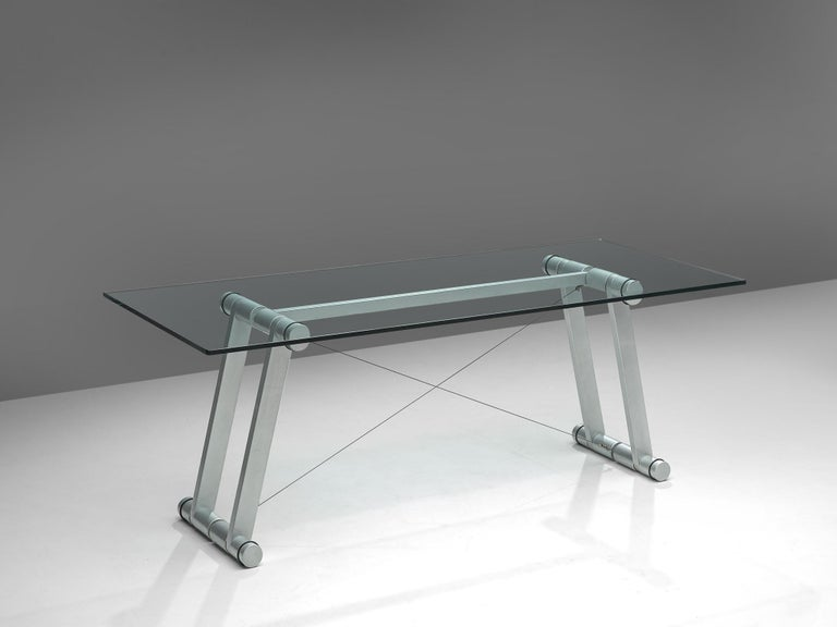 Superstudio, dining table, in metallic lacquered metal and glass, Italy 1970s.   Exceptional table by the Italian architects of Superstudio. The rectangular work table has a clear glass top. The frame consist of four large tubular legs of metallic