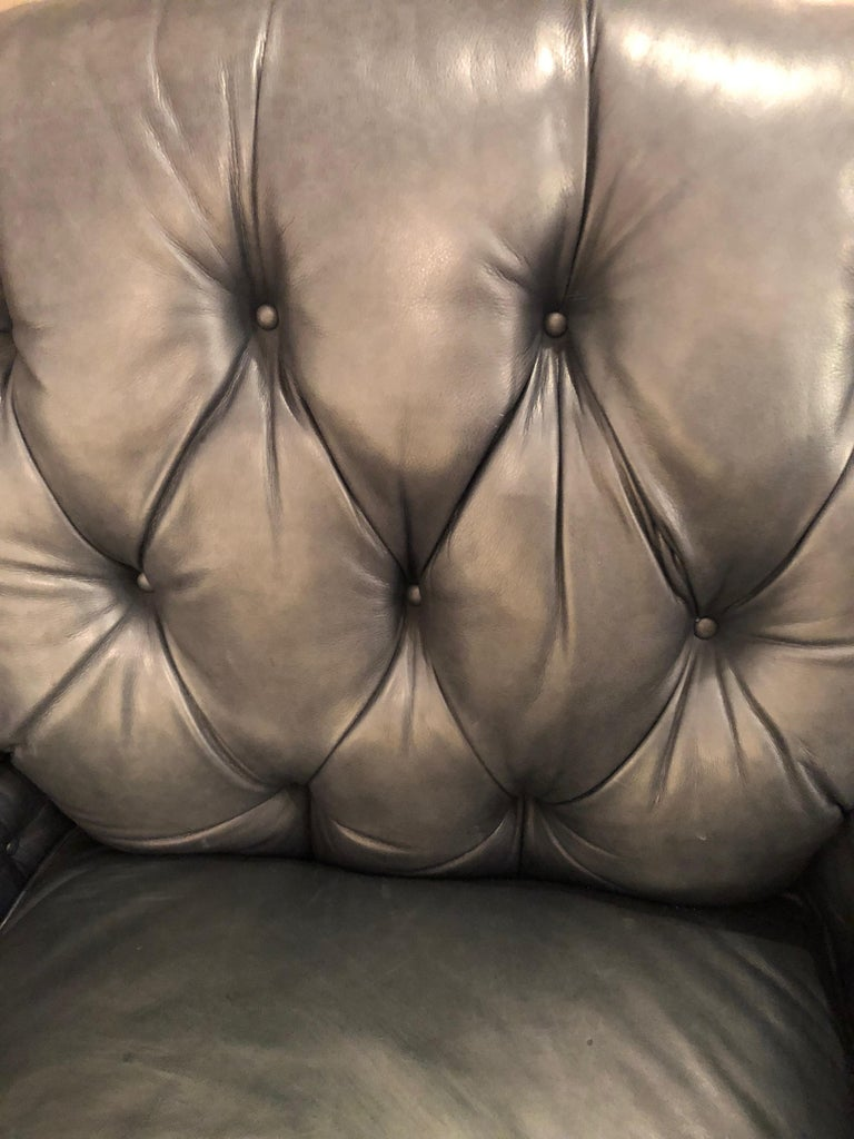 Late 20th Century Supple Blue Leather Beckoning Club Chair and Ottoman by Edward Farrell For Sale