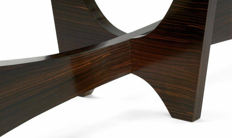 Surfboard shaped cocktail table in Macassar ebony and hand worked glass.  Available now in Inventory dimension: 21