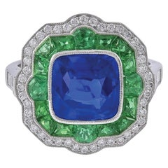 Surprising Platinum Two-Tone Sapphire and Emerald Ring with Pave Set Diamonds