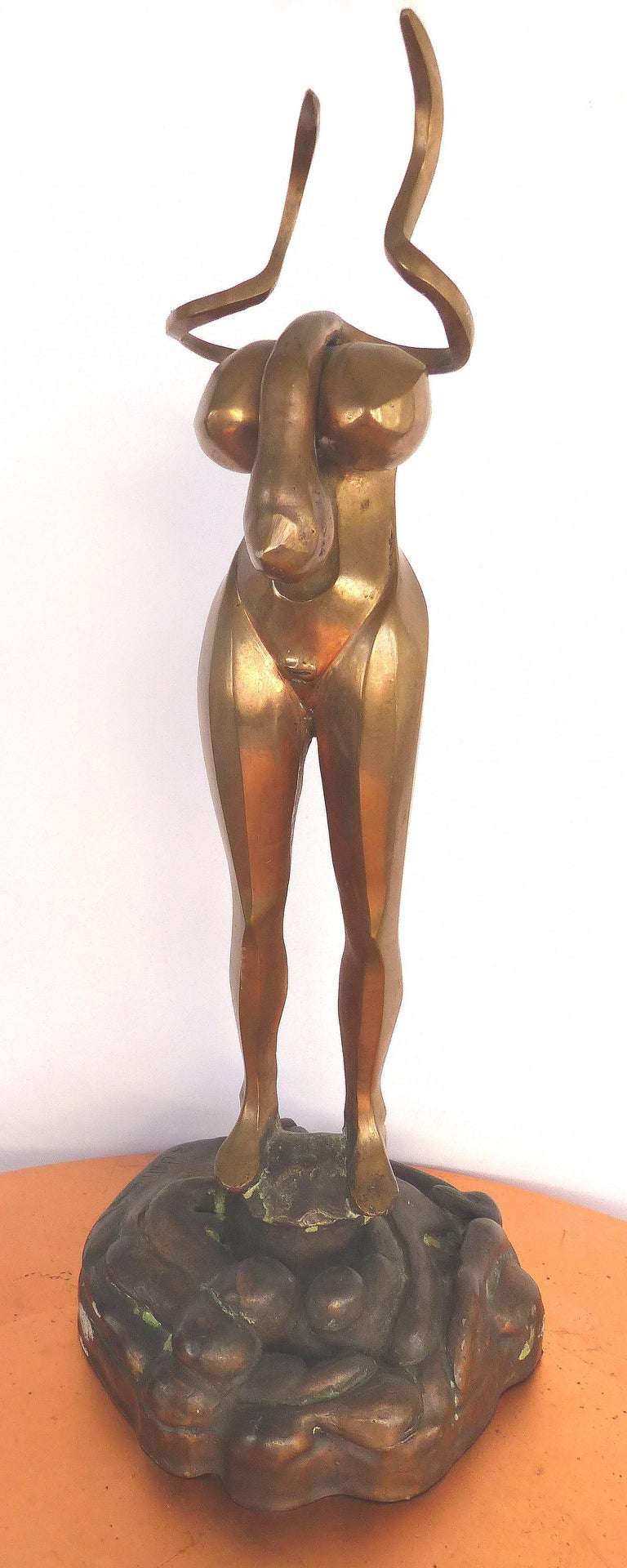 Surrealist Figurative Bronze Signed Zuñiga and Dated, 1977  Offered for sale is a rare estate find of a gilt and patinated bronze of a surrealist standing figure with grotesque features. Signed Zuñiga on the patinated base and dated 1977. As we are