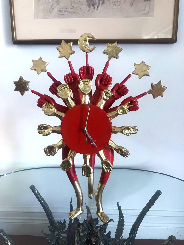 An iconic craved sculptural clock by the famed Mexican surrealistic artist and designer Pedro Friedeberg (Mexican, b. 1937) circa 1960s. The whimsical design incorporates the signature elements made famous by the designer, the many different hand