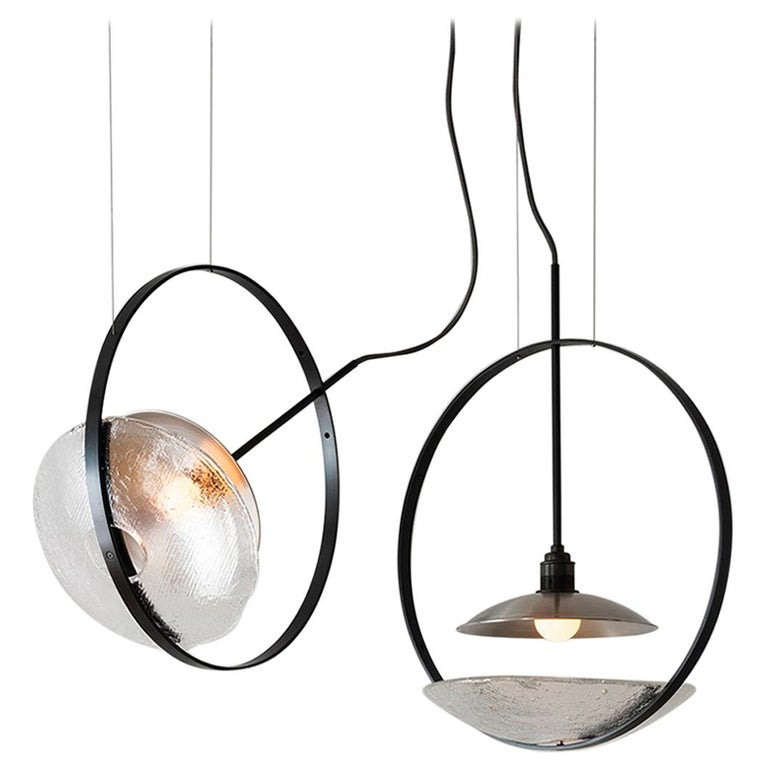 The Surround pendant is a fully adjustable wash light featuring The Studio's original iron-cast glass. Drawing on a background in theatrical lighting design, the goal was to create a light that projects a smooth and even glow around the space. New