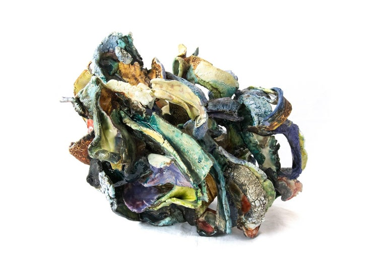 """Sculpted of earthenware paper clay, this playful piece by Canadian ceramicist Susan Collett is multifired to achieve complex and colorful surfaces. The piece is rich with craquelure in hues of green, yellow, violet and orange.  """"My full time studio"""