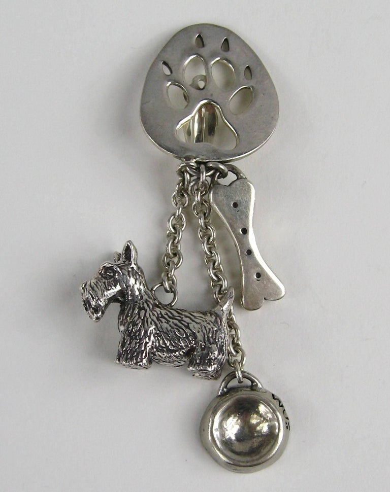 Susan Cummings adorable Dangle Clip on's earrings 3-D Dog along with a dog bone and bowl Measuring 3.25 inches long .84 wide on your ear lobe. There are more pieces of Cummings on our storefront. This is out of a massive collection of Hopi, Zuni,