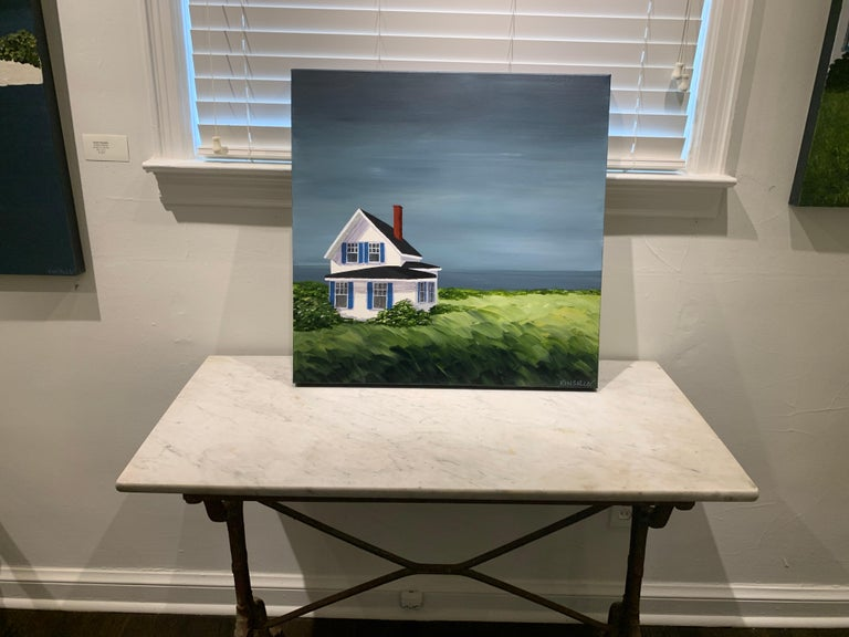 'Comfort Cottage' is a contemporary acrylic on canvas painting of square format, created by American artist Susan Kinsella in 2020. Featuring a light, luminous palette mostly made of blue, neutrals, green, blue and white tones. The foreground,