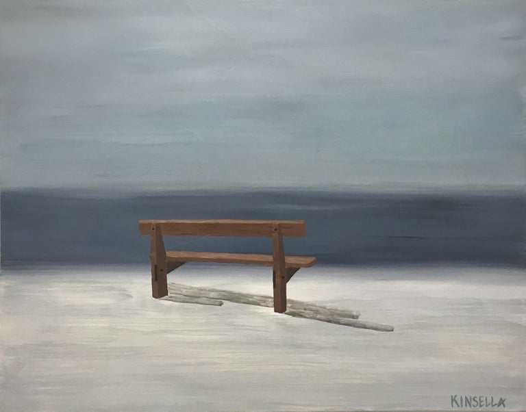 'Still Resting' is a small contemporary acrylic on canvas painting created by American artist Susan Kinsella in 2019. Featuring a palette made of grey and brown tones, the painting depicts a humble bench overlooking the sea. We are immediately