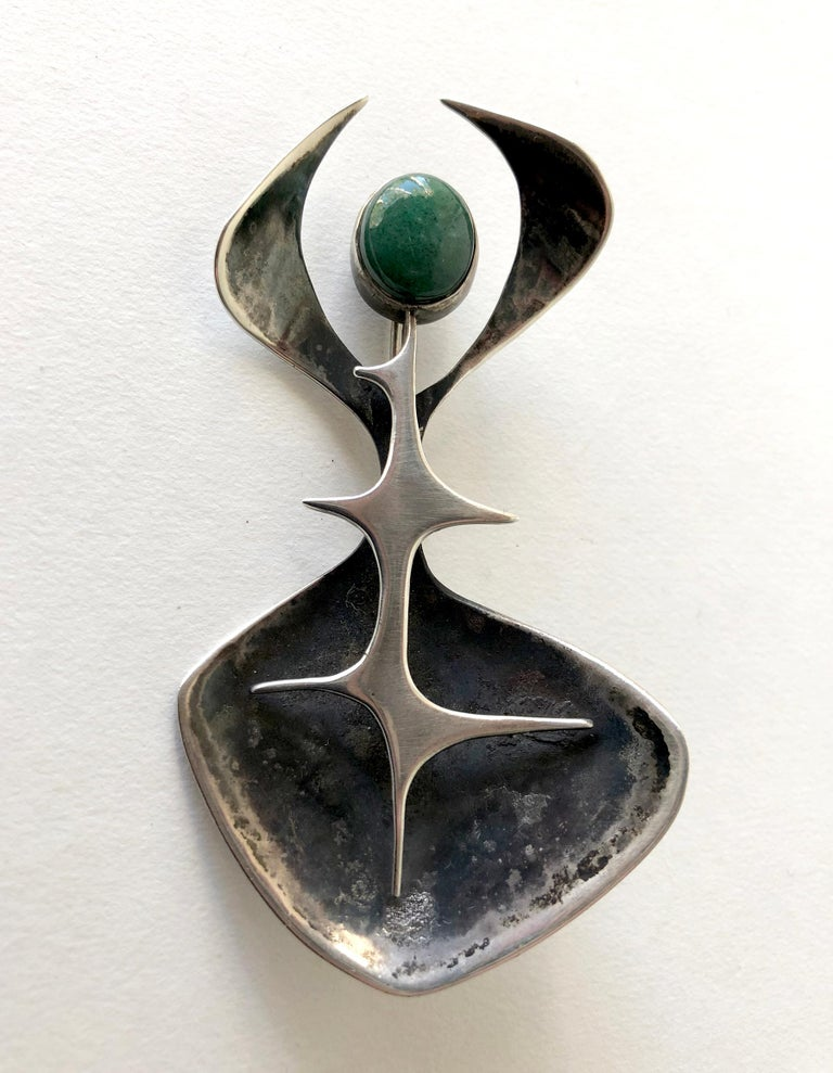 1950's sterling silver abstract modern brooch featuring an aventurine cabochon created by jeweler Susan Saunders Cook of Canandaigua, New York.  Brooch measures 3 5/8