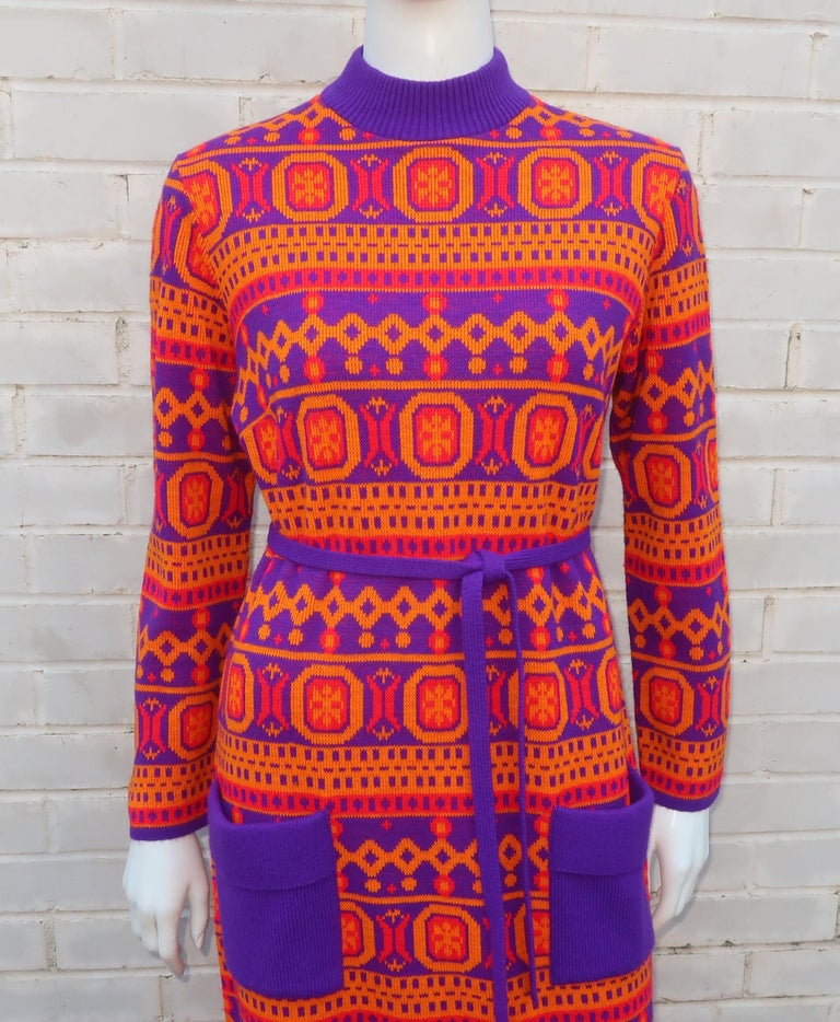 1970's Susan Small maxi sweater dress with a mod geometric motif in a vibrant color combination of red, orange and purple.  Susan Small was a British ready-to-wear clothing line opened in the 1940's with a reputation for party dress designs.  By the