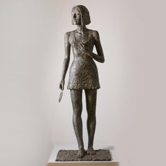 Milan - contemporary bronze sculpture of life-size Woman holding feather