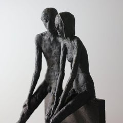 Unity - contemporary bronze sculpture of a nude couple sitting on a bronze block