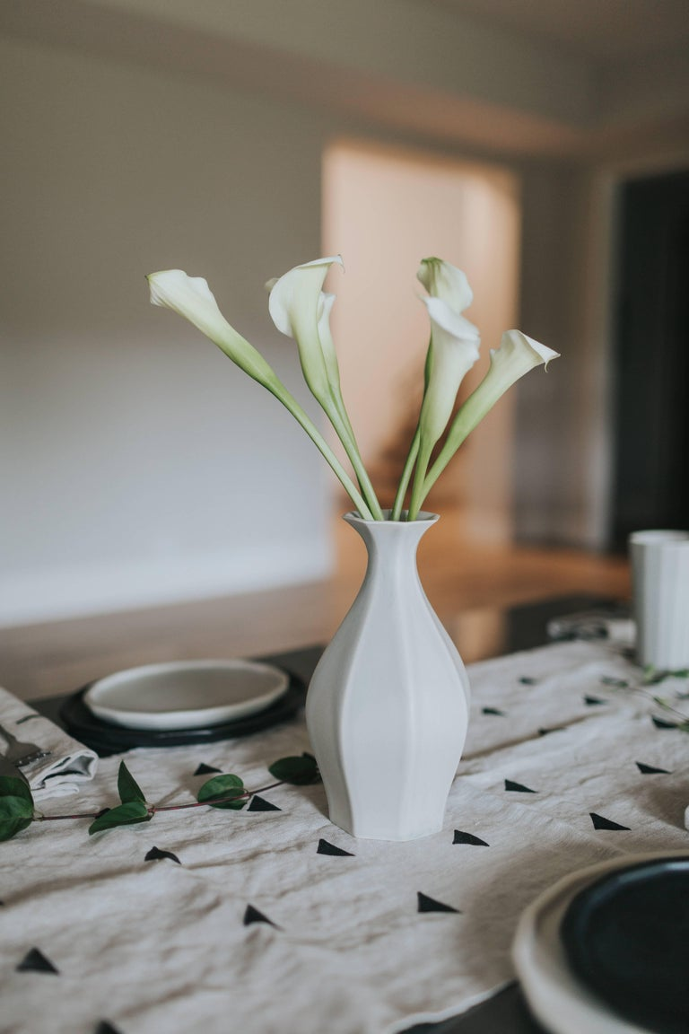 Table vase -Because your flowers need a pretty place to live. This sleek vase was designed with a small opening to showcase a minimal bouquet with style. The table vase is an elegant vase design to hold flowers in the modern home. Adding this