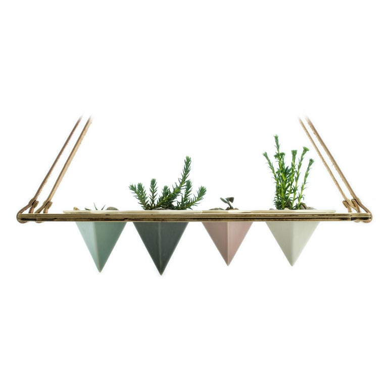 Suspended planter -A cohesive, beautiful set up for any home - plant your favourite succulents and enjoy the view. Lightweight combination of porcelain in assorted colors, wood, and leather from In Blue Handmade - a collaboration with In Blue