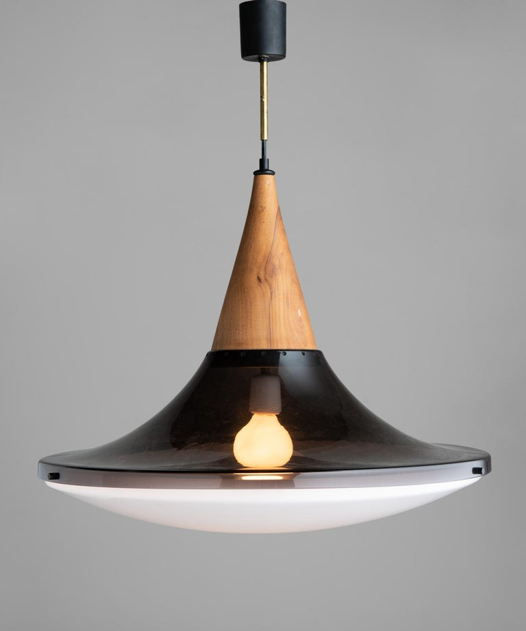 Suspension lamp by Goffredo Reggiani, Italy, circa 1960.  With wooden fitter and two-part plexiglass shade.  Measures: 24