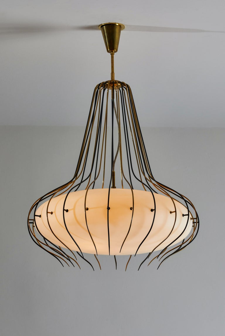 Suspension light by Angelo Lelli for Arredoluce. Designed and manufactured in Italy, circa 1950's. Brushed satin glass diffuser, enameled metal, brass. Original brass canopy, custom brass ceiling light. Takes three E27 60w maximum bulbs. Bulbs
