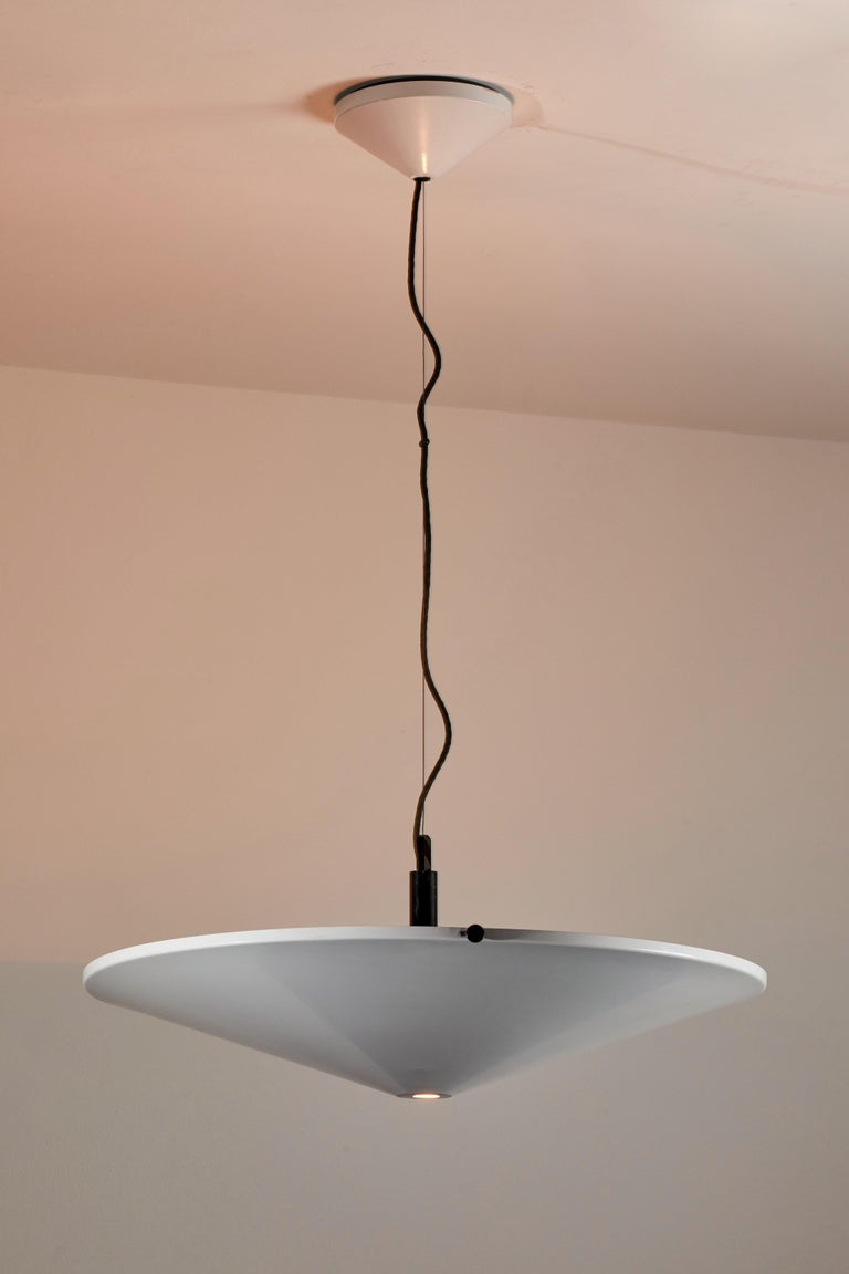 Suspension light by Arteluce. Manufactured in Italy, circa 1970s. Enameled metal. Rewired for U.S. junction boxes. Takes one Halogen 200w maximum bulb. Bulb provided as a one time courtesy.