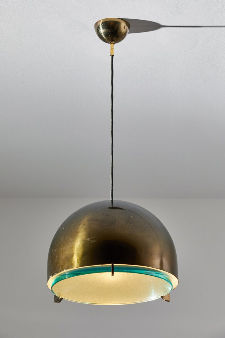 Suspension light by Fontana Arte. Manufactured in Italy, circa 1960's. Brass shade, glass diffuser. Original canopy. Rewired for U.S. junction boxes. Takes one E26 100w maximum bulb. Bulbs provided as a one time courtesy.
