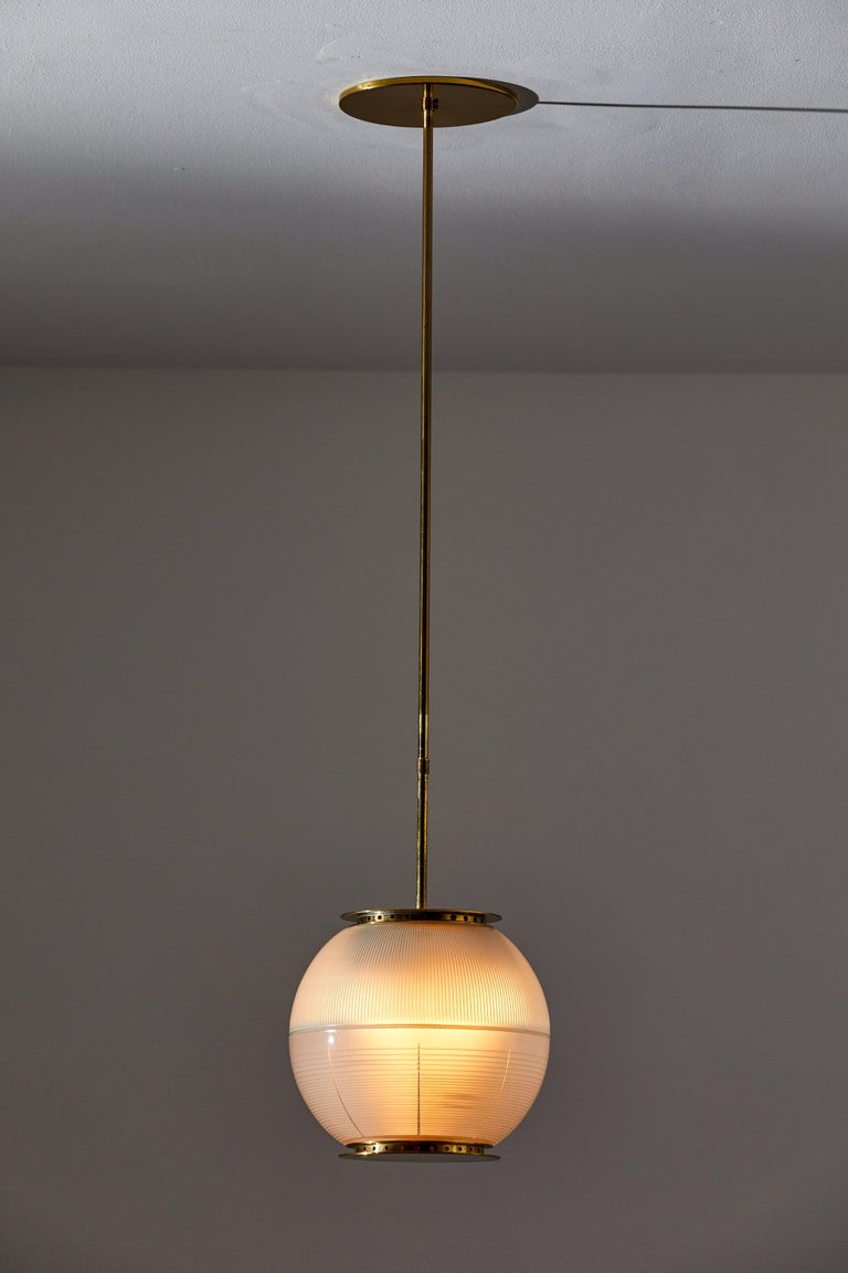 Suspension light by Ignazio Gardella for Azucena. Designed and manufactured in Italy, circa 1950s. Opaline glass diffuser, brass hardware. Custom brass canopy. Rewired for U.S. junction boxes. Takes three E27 60w maximum bulbs. Bulbs provided as a